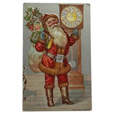 Santa Claus In Red Suit Holding Gifts And Address Book