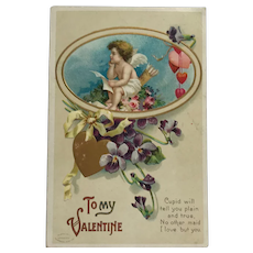 Thoughtful Valentine Cupid Sending Messages Of Love Postcard