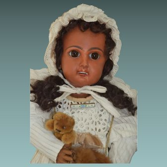 "Beautiful cabinet size around 16"" tall French mulatto doll."