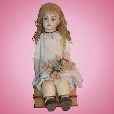 "Artist made Bru doll with an original Bru body 24"" tall."