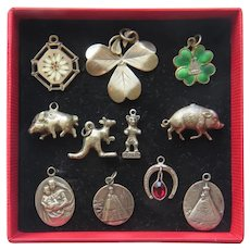 A Fine Collection of 11 Antique Silver Charms, early 20th century