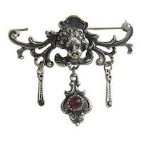 Antique silver Cherub brooch with Garnets , 19th century