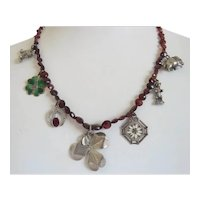 Antique Garnet necklace with 7 silver charms, 19th century