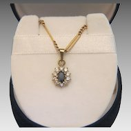 Vintage  Sapphire and Zirconia pendant, set in 10 karat yellow gold, ca. 1960