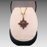 Garnet star shaped pendant ,set in gilt silver hallmarked 900 ,ca. 1960