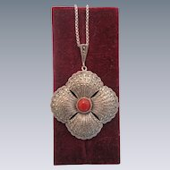 Art Nouveau pendant with a red Coral in the center and Marcasites, ca.1910