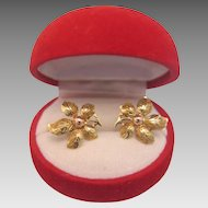 A pair of fourteen karat yellow gold flower earrings, ca. 1950