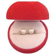 Pair of cultured pearl and diamond earrings, 14k white gold, dated at ca. 1970