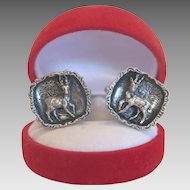 Silver cufflinks with a hunting scene, silver 800, ca. 1920