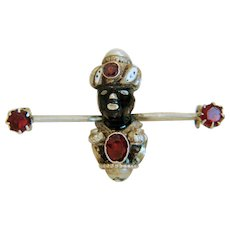 Antique Blackamoor Garnet and enamel brooch, 19th century