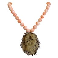 Coral bead necklace with antique lava Cameo brooch/pendant, 19th century