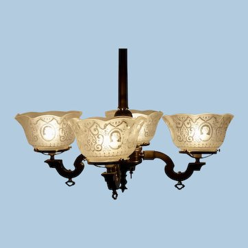 Four Arm Transitional Neo-Grec Chandelier with Antique Shades