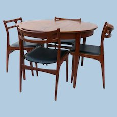 Danish Modern Teak Dining Table and 4 Chairs by Johannes Andersen for Uldum Mobelfabrik, Denmark.