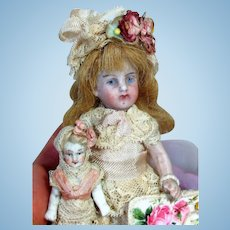 "Sweet 4"" All Bisque Mignonette (swivel head) doll & 2"" Dolly"