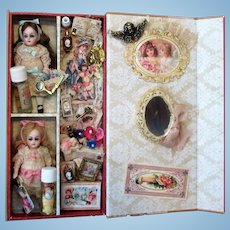 "Two Lovely 3 3/4"" All Bisque (glass eyes) Mignonette Dollhouse doll sisters in Display Box of accessories"