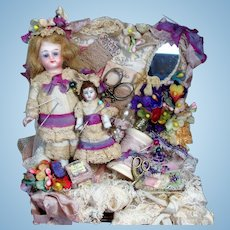 """ Lace Box Sweeties"" Tiny 3 1/2"" All Bisque (glass eyes) Mignonette doll & 2"" Dolly in trunk of Laces & Pearls"