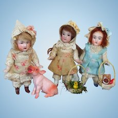 "Three Tiny 3 1/2"" (swivel neck) All Bisque German Mignonette Dollhouse Farm Girls with tiny pig & accessories"