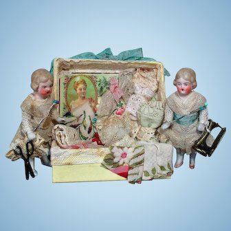 """""""Lace Box Sisters"""" Two sweet 3 1/4"""" All Bisque Miniature Dollhouse dolls with trunk of Laces  & Fabrics"""