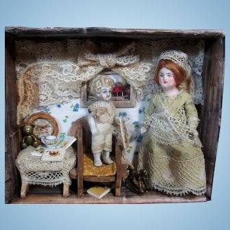 """ Read Me a story Mamma"", A Cozy room box with 3 1/2"" All Bisque Miniature Dollhouse Mom Doll & 2"" Baby"