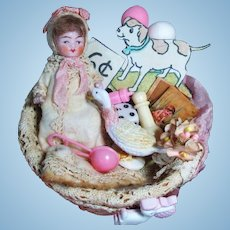 "Mini little 3 1/2"" All Bisque Miniature Dollhouse Baby doll with basket of accessories"