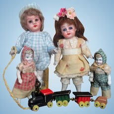 "Two so sweet 4"" All Bisque (glass eyes & swivel head) Brother & sister dolls with two tiny Siblings & toys"