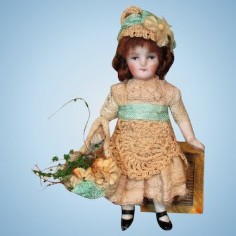"""Precious 3 1/2"""" All Bisque Mignonette dollhouse doll with flower basket"""