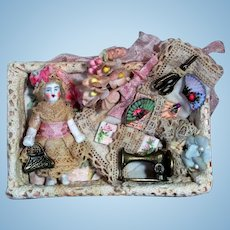 """Sweet little 2"""" all Bisque Miniature Dollhouse doll in Sew box display"""