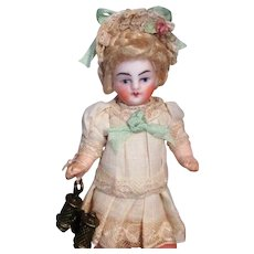 """Lovely  3 1/4"""" Bisque ( Swivel head) Mignonette Dollhouse Doll w/Trunk of accessories"""