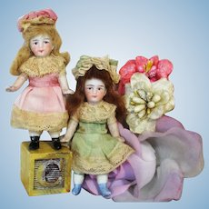 """ Flower Sisters"" Two Tiny 3 1/2"" All Bisque Pocket size German Dollhouse doll sisters"