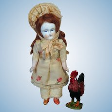 """Lovely 6"""" All Bisque ( swivel Head) Mignonette doll & Rooster"""