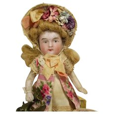 """Tiny 3 1/2"""" All Bisque Mignonette Dollhouse doll with sewing accessories"""