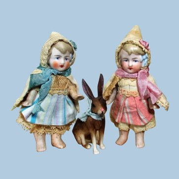 """Two 3 1/2"""" All Bisque Miniature Dollhouse doll sisters with Bunny Friend"""