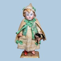 """Lovely unusual 4 1/2"""" All Bisque German Miniature Dollhouse doll with piglet"""