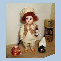 """Chubby Little 41/2"""" ( Glass eyes, Swivel head) All Bisque Chef boy doll and chicken"""