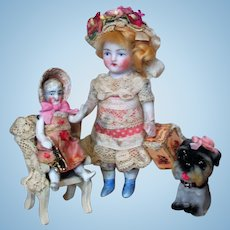""" Pretty in Pink Sisters"" Two lovely 4 1/4"" All Bisque German Mignonette Dollhouse doll & 2 1/2"" Sister Dolly with Puppy"