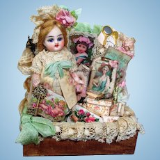"""Lovely 3 3/4"""" All Bisque (glass eyes, swivel neck) Mignonette Doll in trunk of accessories"""