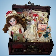 """Lovely 4 1/2"""" All Bisque (glass eyes) Mignonette Doll & 2 dollies in trunk of toys"""