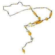 Art Deco Handmade Pale Yellow Satin Swirl Glass Bead Lavalier