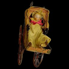 "Vintage Bisque Baby In Her Tin Painted ""Pink"" Baby Buggy"