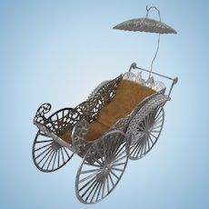 Lovely Large Ornate Antique Soft Metal Doll's Pram with Original Velvet Seat.