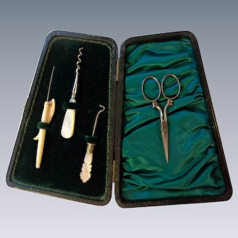 Black Leather Antique Sewing Kit with 4 Mother of Pearl Utensils and a Pair of Scissors c1800s