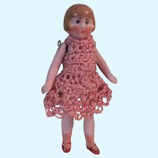 Lovely Little All Bisque Pink Tint German Girl in Pink Crocheted Dress