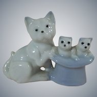 A Wonderful Vintage Porcelain Momma Cat with her 2 Kittens in a Hat