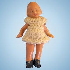 """Darling 2"""" Hertwig Miniature Painted All Bisque Doll with Crocheted Dress"""