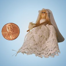 "Tiny 1-3/4"" Vintage Wooden Bride Doll"