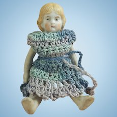 "Adorable 3-1/2"" Early White All Bisque Jointed Doll with Blue Crochet Dress"