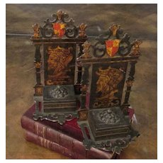 Ornate Iron Bookends With Hand Painted Soldier Heads In Profile, Circa 1900