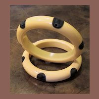 A Pair Of Polka Dot Bakelite Bangle Bracelets In Cream With Dark Green Dots, Circa 1930