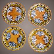 A Set Of Four Majolica Lilac Plates
