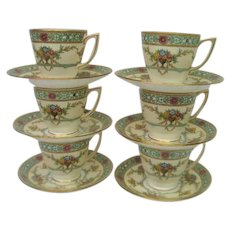 Six Painted Minton Demitasse Cups and Saucers